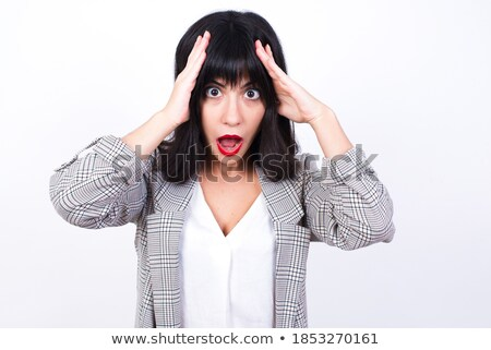 Portrait of frightened young woman in a checkered jacket Stock photo © acidgrey