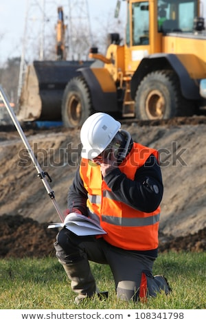 Site surveyor taking readings Stock photo © photography33