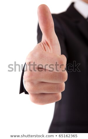 Smiling young business man thumbs up, isolated on white. Focus o Stock photo © dacasdo