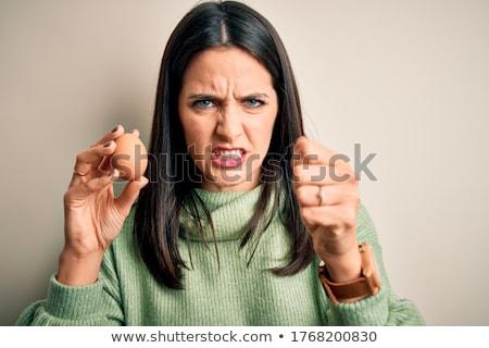Nő kéz tart tojás nyers csoport Stock fotó © taden