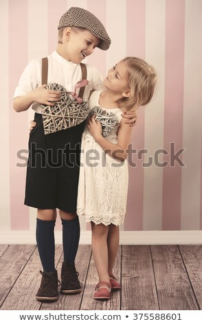 Two laughing kids holding wicker heart Stock photo © konradbak