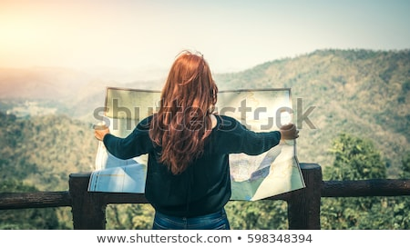Girl reads the map outside Stock photo © d13