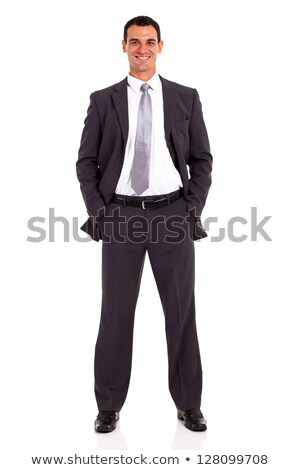 young business man standing with both hands in pockets Stock photo © feedough