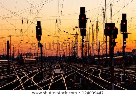 Rouge train signal image coucher du soleil bleu Photo stock © w20er