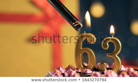 burning birthday candles number 63 stock photo © zerbor