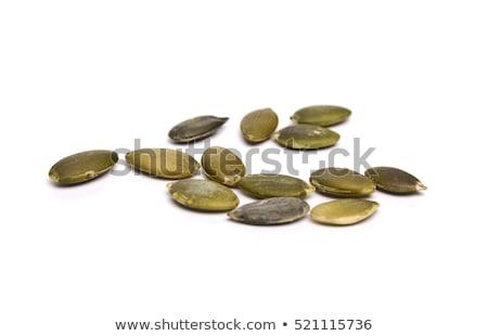 Pumpkin seeds on a white background Stock photo © EwaStudio
