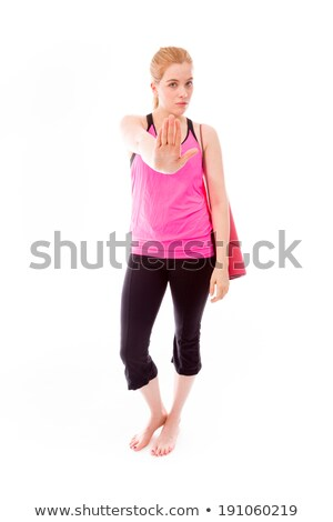 Young woman making stop gesture sign with carrying exercise mat Stock photo © bmonteny