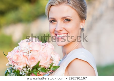 Smiling bride with bouquet Stock photo © dashapetrenko