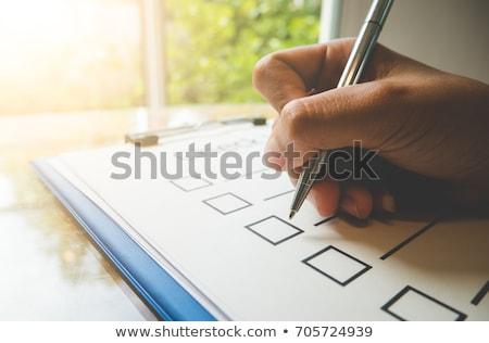 Lista espiral cuaderno negro marcador escrito Foto stock © pedrosala