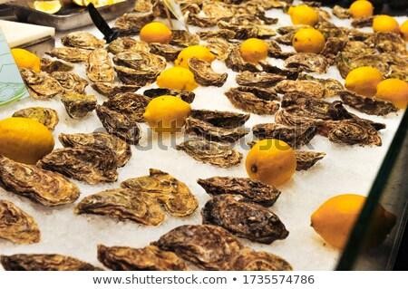 Schelpdier markt verkoop Barcelona oranje groep Stockfoto © elxeneize