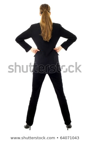 Young businesswoman standing with arms akimbo on white background studio stock photo © ambro
