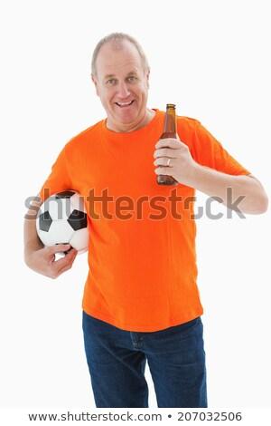 зрелый человек оранжевый футболки футбола Сток-фото © wavebreak_media