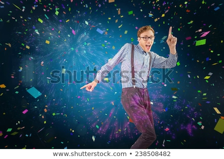 Geeky hipster dancing and smiling Stock photo © wavebreak_media
