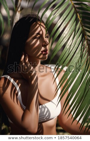 Seductive attractive brunette touching her hair Stock photo © wavebreak_media