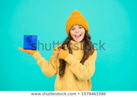 little girl unpacking her birthday gift stock photo © dash