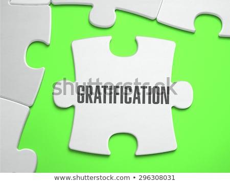 Gratification - Jigsaw Puzzle with Missing Pieces. Stock photo © tashatuvango