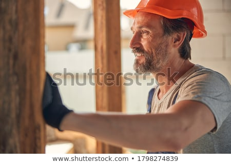 close up of smiling builder hands in gloves Stock photo © dolgachov