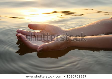 Stock photo: Woman's hands with water splash.