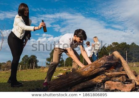Femme homme bois de chauffage portrait extérieur feu Photo stock © deandrobot