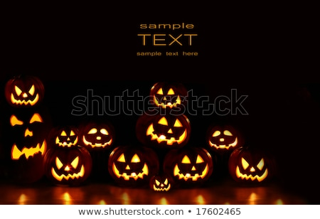 Lots of pumpkins lit brightly against a black Stock photo © vlad_star