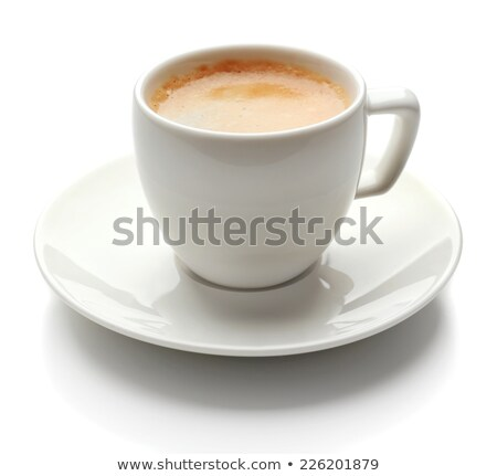 granules of instant coffee in a white cup and saucer isolated on Stock photo © tetkoren