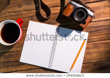 Kalem notepad fincan kahve kamera kahve Stok fotoğraf © wavebreak_media