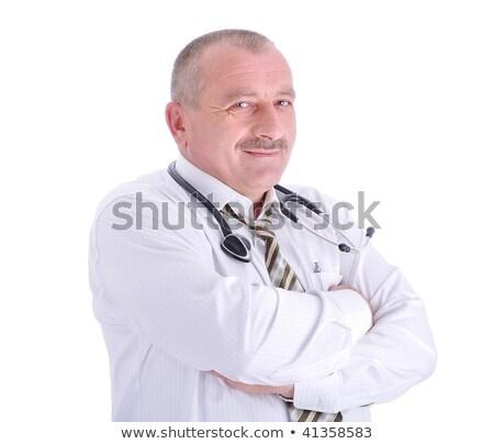 Positive elderly male doctor in characteristic clothes Stock photo © zurijeta