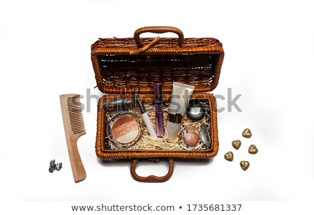 Wooden combs in the Rattan basket isolated stock photo © myfh88
