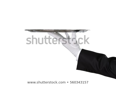 Stock photo: Waitress holding a silver tray isolated on white.