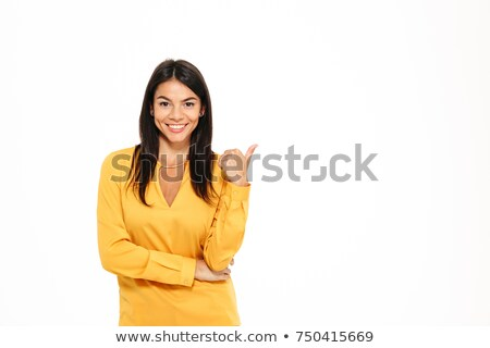 happy young businesswoman pointing fingers away at copyspace stock photo © deandrobot