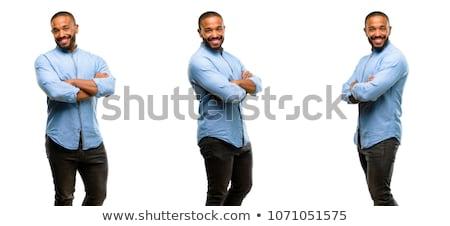 Boldog trendi férfi pózol fekete póló Stock fotó © nyul