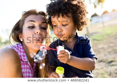 Anya játszik baba buborékok fiatal szappanbuborékok Stock fotó © dariazu
