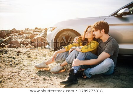 young travelers couple standing near car outdoors stock photo © deandrobot