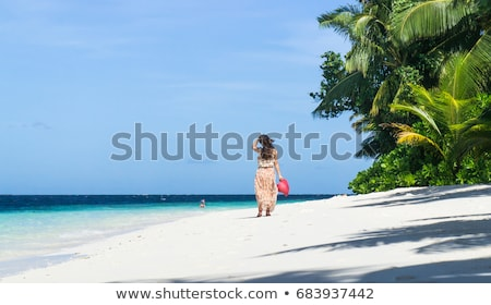 Lonely girl in the beach Stock photo © artfotodima