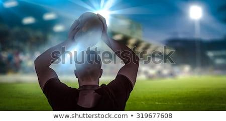 Déterminé joueur ballon de rugby herbe Photo stock © wavebreak_media