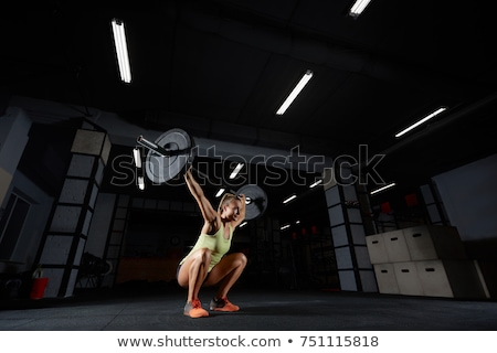 fitness woman preparing barbell squats in a gym Stock photo © chesterf