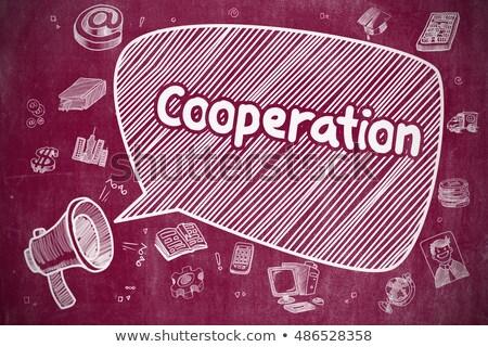 Cooperation - Hand Drawn Illustration on Red Chalkboard. Stock photo © tashatuvango