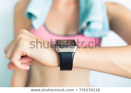 woman with heart rate watch in gym stock photo © dolgachov
