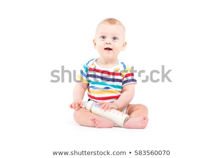 cute joyful baby boy in colorful shirt hold milk bottle Stock photo © Traimak