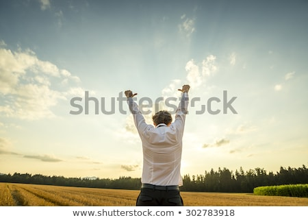 Man in open field during sunset Stock photo © IS2