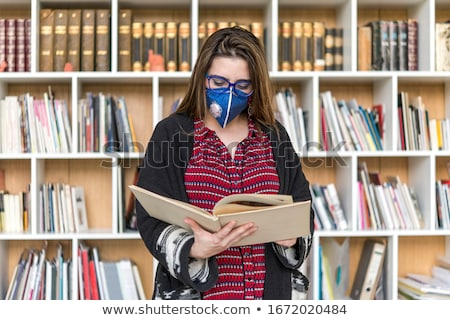 girl reading in library stock photo © is2