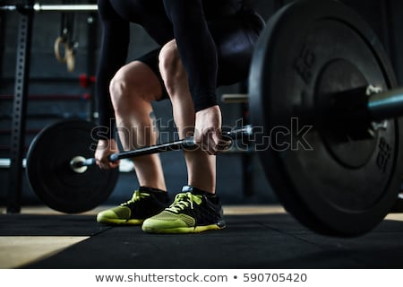 Low section of man lifting barbell Stock photo © wavebreak_media