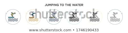 Homme sautant eau planche de surf amusement énergie Photo stock © IS2