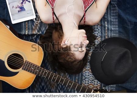 Girlfriends lying down at the beach. Stock photo © Massonforstock