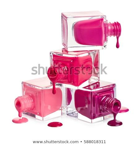 Coloured nail polish bottles on a white background stock photo © boggy