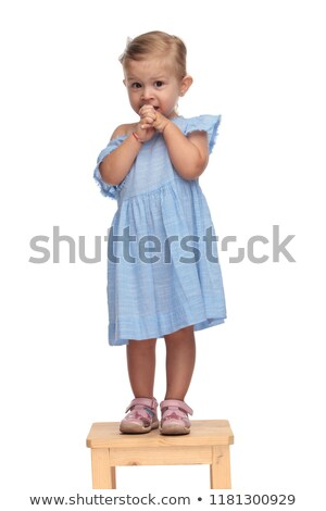 little cute baby girl is beig scared and looks  anxious  Stock photo © feedough