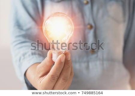 businesswoman holding illuminated light bulb stock photo © andreypopov