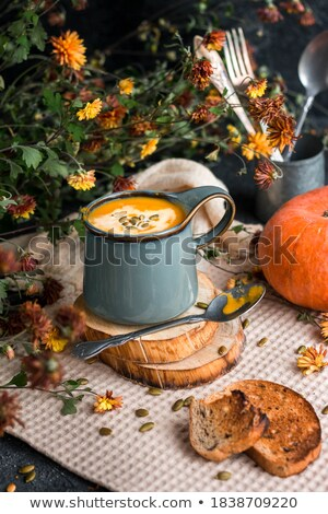 Soup in plate with pumpkins around Stock photo © dash