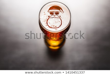 Santa Claus with a mug of beer foam. Christmas and New year Stock photo © rogistok