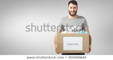 Happy Man Donating Clothes Stock photo © AndreyPopov